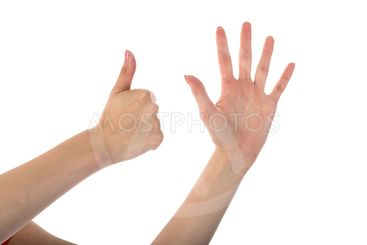 Female hands showing six fingers isolated on white...