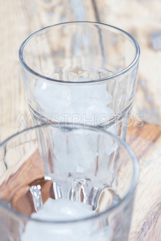 Two glasses with ice cubes