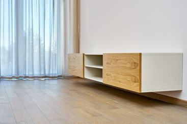 Floating media cabinet in contemporary living room. Wall...