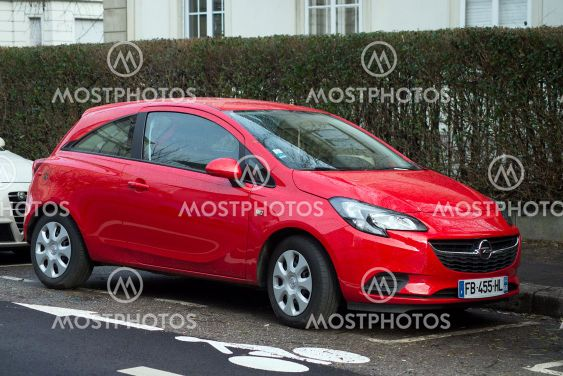 Front view of red Opel Corsa parked in the street, Opel...