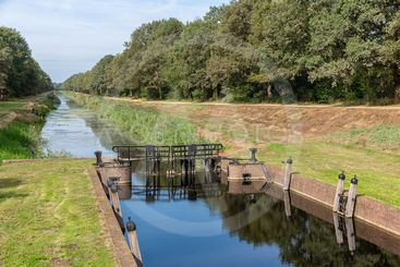 Dutch countryside in region Twente with canal and sluice