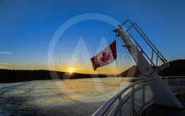 Canadian flag on a ferry at sunset