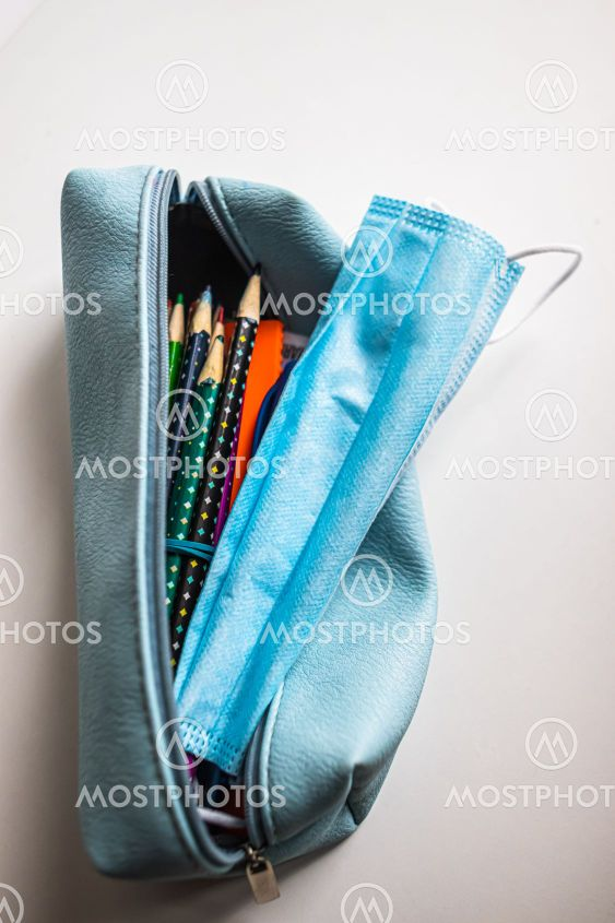 Pencil-case with protective face medical mask in on...