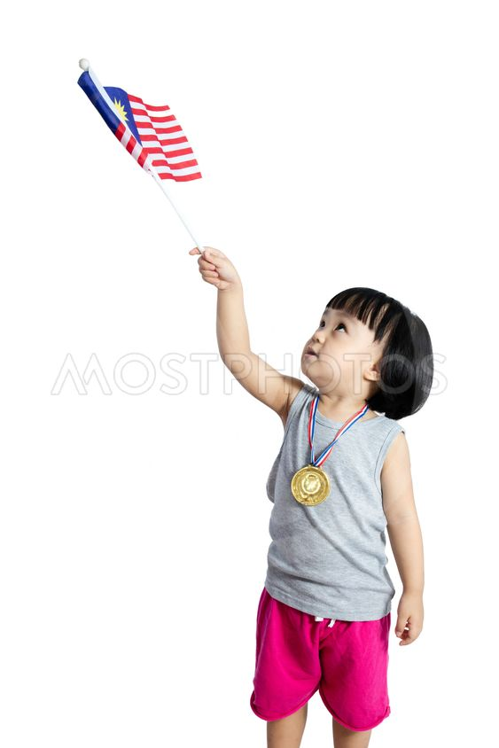 Asian Chinese little girl holding Malaysia Flag with gold...