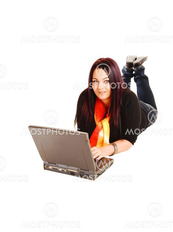 Girl lying on floor with laptop.