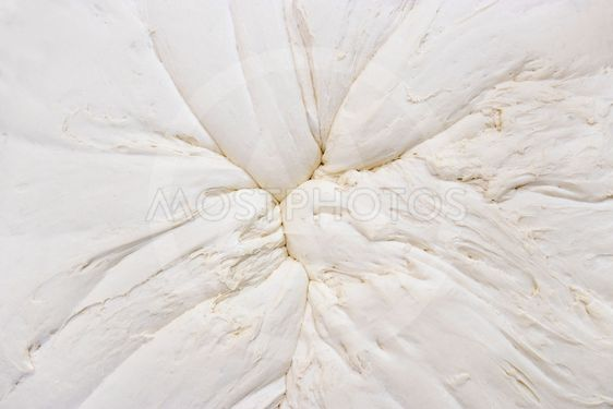 Mixed dough background from above that stands to leaven