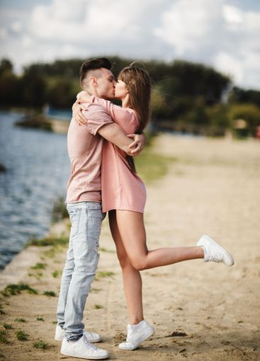 Loving young couple kissing and hugging in outdoors....