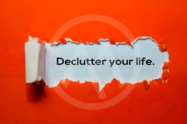 Close up Declutter Your Life written in red torn paper