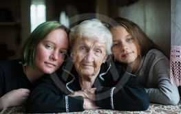 Family portrait of grandmother with two girl...