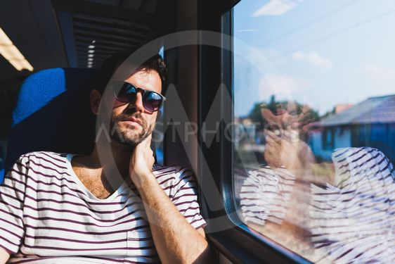 Young man traveling on a train