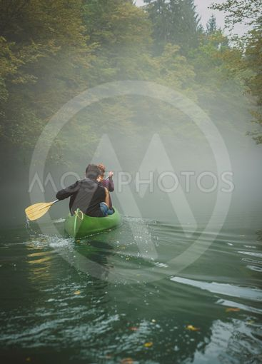 Canoeing in a cold and foggy environment