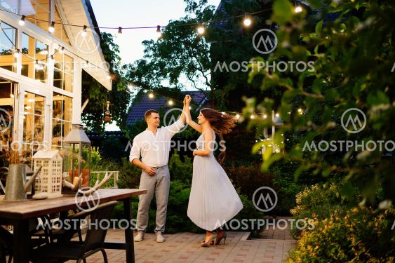pregnant woman and man is dancing in garden