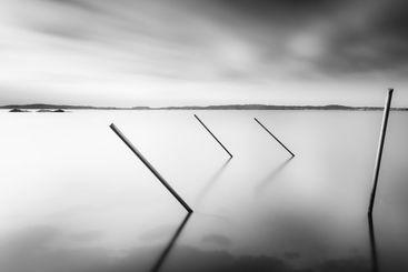 Long exposure of 4 poles in water, Sweden.