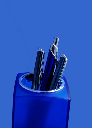 Pens in blue container