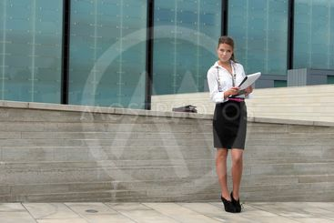 business woman is holding a folder on the business...