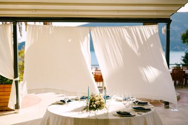 Wedding dinner table reception. Round table with a...
