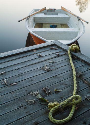 Boat moored at pier, Sweden.