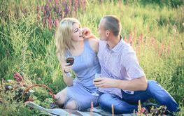 Romantic happy couple in meadows nature sunny day.