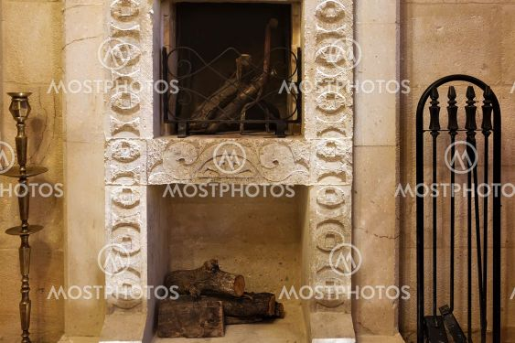 Interior details. The fireplace is made of natural stone