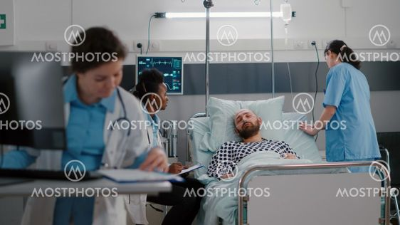 Medical practitioner doctors checking sick man analyzing...