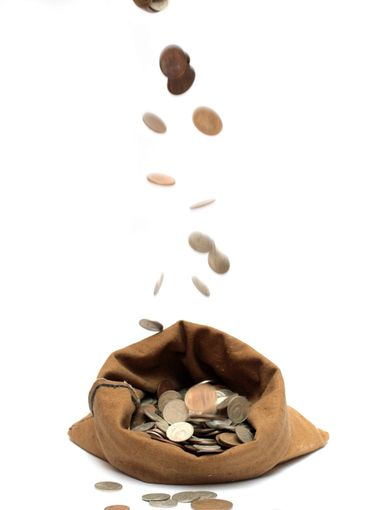 flying coins, falling in bag