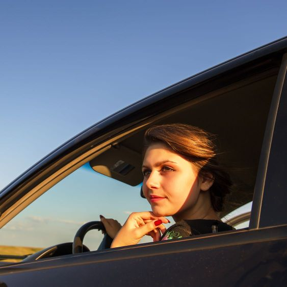 woman drives a car