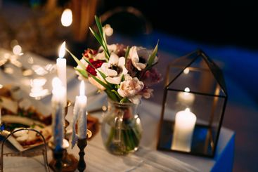 Wedding dinner table reception. A bouquet of flowers in...