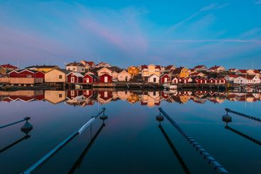 Colourful houses reflected in a still harbour