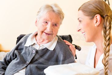 Nurse bringing supplies to woman in retirement home