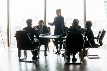 Serious businesswoman manager speaks in boardroom at...
