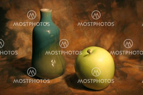 Still life with vase and apple