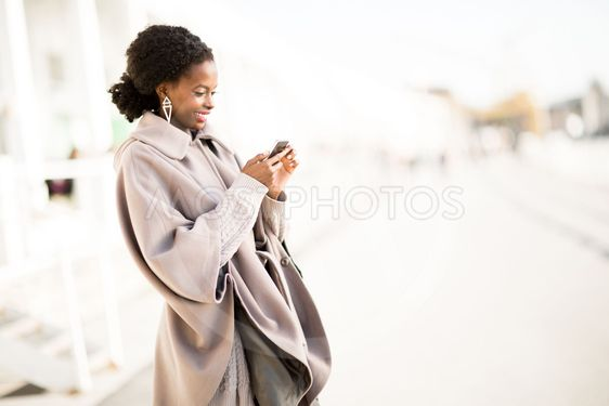 Young black woman taking selfie outdoor