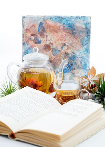 reading a book and waiting for floral tea to brew