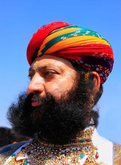 Portrait of indian man taking part in Mr Desert...