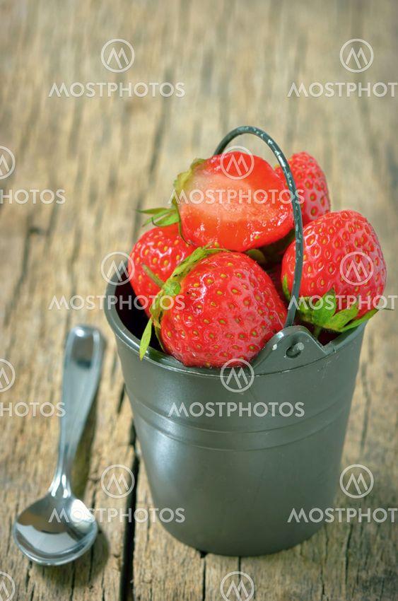 Fresh strawberries in bucke