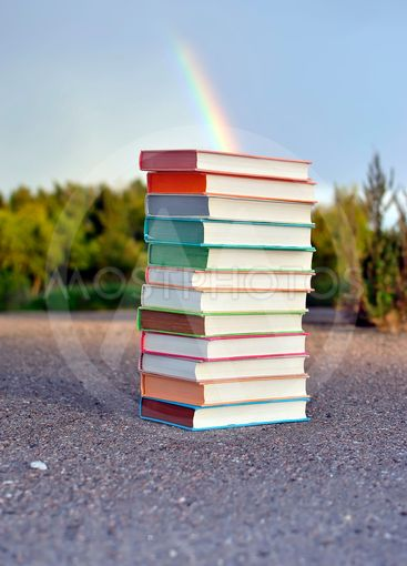 12 different books lying on the pavement