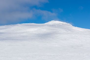 Clean snow mountain ridge with blue sky and sunlight