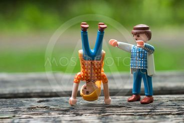Playmobil figurines making sport in outdoor