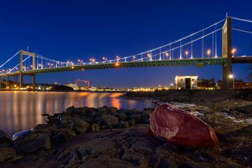 Illuminated bridge over a river
