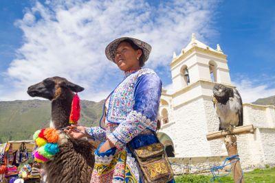 Peruvian woman with her Alpaca.