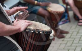 man hands on african drums in outdoor