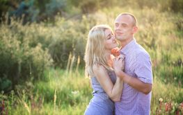 Young couple in the summer on the nature. The concept of...