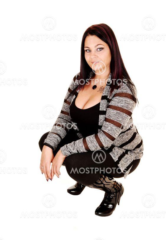 Girl crouching on floor.