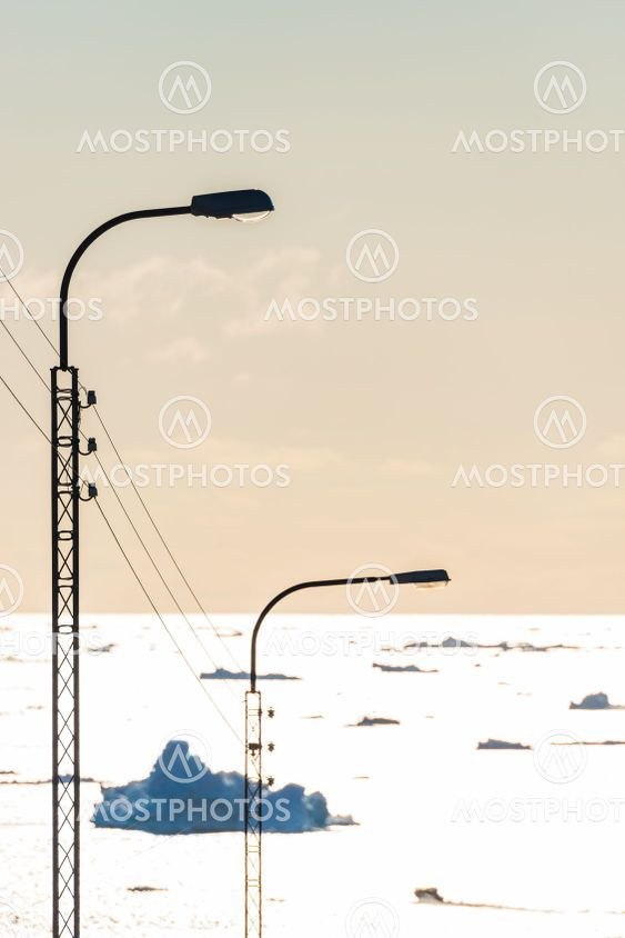 Street lamp in front of sea