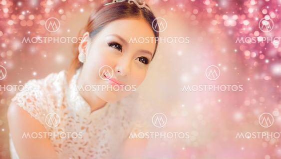 Pretty asian girl with pink bokeh