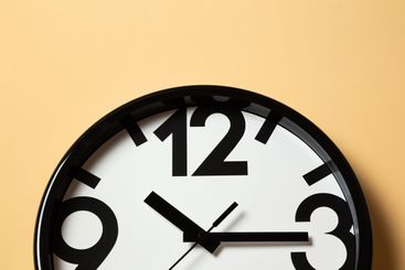 black and white wall clocks show time close-up