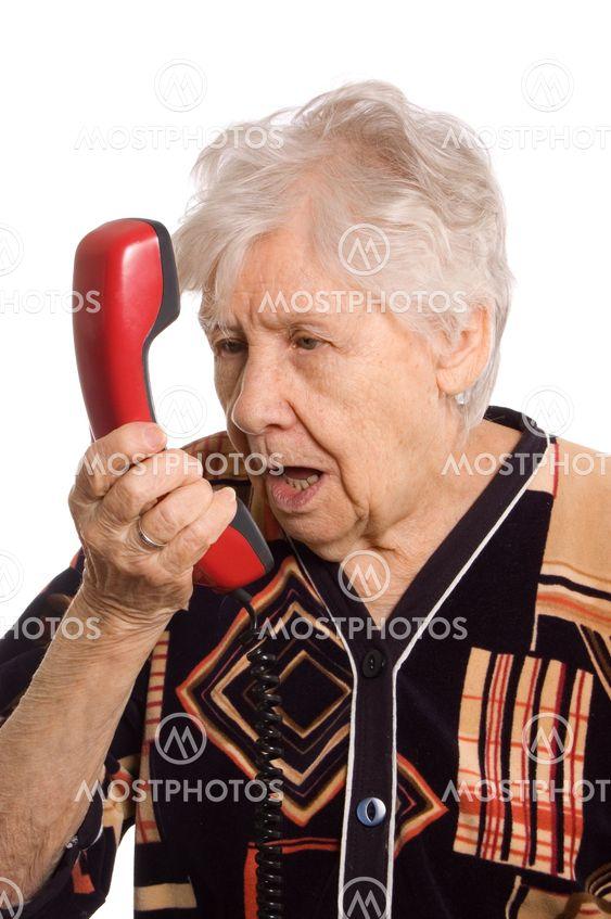 """Ældre kvinde taler i telefon"""" fra Vladimir Voronin - Mostphotos"""