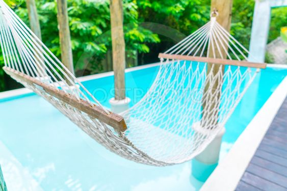 White hammocks in Luxury swimming pool .