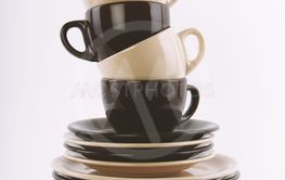 stack of clean dishes in brown and beige