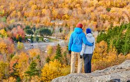 Couple hiking at Artist's Bluff in autumn